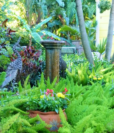 Private Paradise: Color all year long!, We've worked on our garden for the past 12 years. It includes many tropical and flowering plants, trees and fun decor., Garden Water Feature, Gardens Design