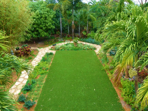 Private Paradise: Color all year long!, We've worked on our garden for the past 12 years. It includes many tropical and flowering plants, trees and fun decor., Bird's eye view of our garden., Gardens Design