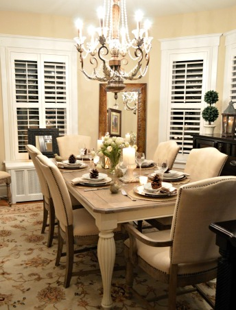 Today's Traditional Dining Room, Our home was built in 1915 so we wanted to maintain a traditional look with updated furnishings that blended with our living room. By adding plantation shutters we got the privacy we needed, but the light still shines in. We love linen and found a great deal on this dining set made of reclaimed barn wood. , Night shot.  , Dining Rooms Design