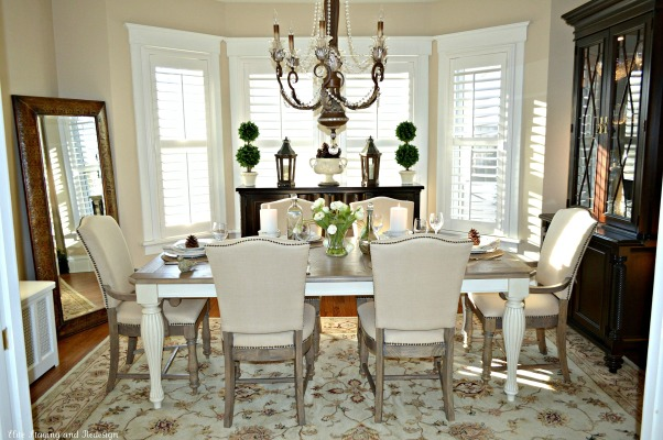 Today's Traditional Dining Room, Our home was built in 1915 so we wanted to maintain a traditional look with updated furnishings that blended with our living room. By adding plantation shutters we got the privacy we needed, but the light still shines in. We love linen and found a great deal on this dining set made of reclaimed barn wood. , Linen fabric chairs with nail heads and reclaimed wood dining table give this room an updated, traditional look.  , Dining Rooms Design