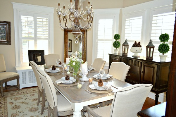 Today's Traditional Dining Room, Our home was built in 1915 so we wanted to maintain a traditional look with updated furnishings that blended with our living room. By adding plantation shutters we got the privacy we needed, but the light still shines in. We love linen and found a great deal on this dining set made of reclaimed barn wood. , We added a leaning wall mirror to reflect the chandelier. For function we purchased a reclaimed wood table that doesn't need a table cloth or pads.  , Dining Rooms Design