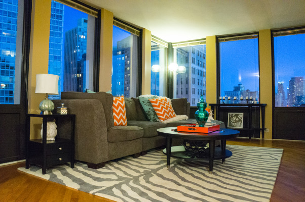 Chicago Condo Living, With a turquoise and gray color palette with pops of orange, I've transformed this space into a bright, cheerful and contemporary getaway in the big city., Living Rooms Design