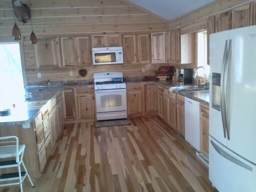 Building our new home, This is a picture of our kitchen as we are trying to finish it. We're building our home and it's just about done.  Regular house out, log cabin in.  , our new kitchen, Other Spaces Design