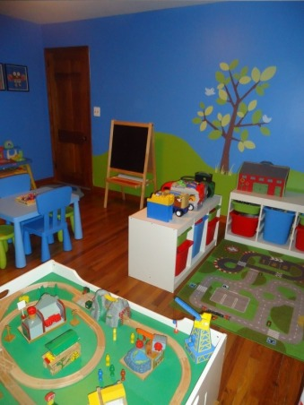 Jace's Playroom, This is my 3 year old's playroom. I wanted a place where he could spend time close by and not have to pick up toys all over my living room at the end of each day. I am a teacher so I wanted the room to have a preschool feel to it. I have several spaces within the room where he can be creative while having fun. I also wanted everything to be organized so clean up time would be easy for him and for me. , This is another view of the room. , Boys' Rooms Design