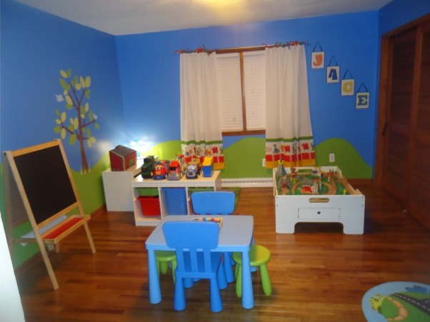 Jace's Playroom, This is my 3 year old's playroom. I wanted a place where he could spend time close by and not have to pick up toys all over my living room at the end of each day. I am a teacher so I wanted the room to have a preschool feel to it. I have several spaces within the room where he can be creative while having fun. I also wanted everything to be organized so clean up time would be easy for him and for me. , Here is the view when you walk into the room. , Boys' Rooms Design