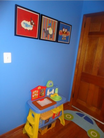 Jace's Playroom, This is my 3 year old's playroom. I wanted a place where he could spend time close by and not have to pick up toys all over my living room at the end of each day. I am a teacher so I wanted the room to have a preschool feel to it. I have several spaces within the room where he can be creative while having fun. I also wanted everything to be organized so clean up time would be easy for him and for me. , I made these pictures using scrapbook materials and my little boy's handprints. , Boys' Rooms Design
