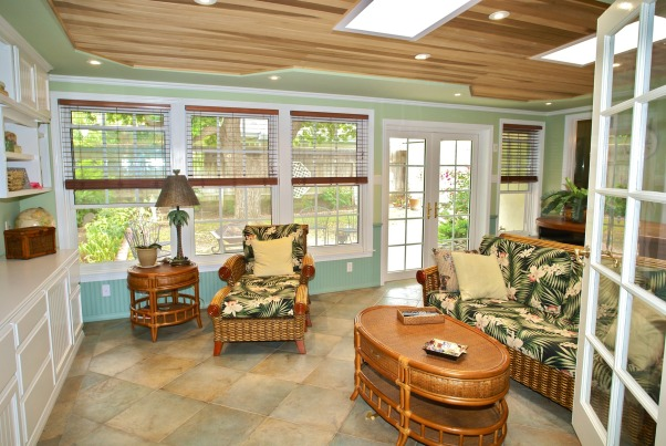 Sunny Sunroom, An addition added with beautiful double-paned windows, wainscoting, built-in shelving & entertainment unit.  Also tile is Italian porcelain and we added floor heating.  Built a table unit of teak around the wetbar to be used for meals or networking.  The French doors lead to the outdoor gazebo we also built., Hawaiian style sunroom my husband & I built.  Floors are heated Italian porcelain tile, and there is a lot of light with two sunlight windows above.  We framed the double-paned windows & added wainscoting & had shelving installed as an Entertainment unit with lights.  Ceiling we decided to not stain & recessed lighting adds ambience., Living Rooms Design