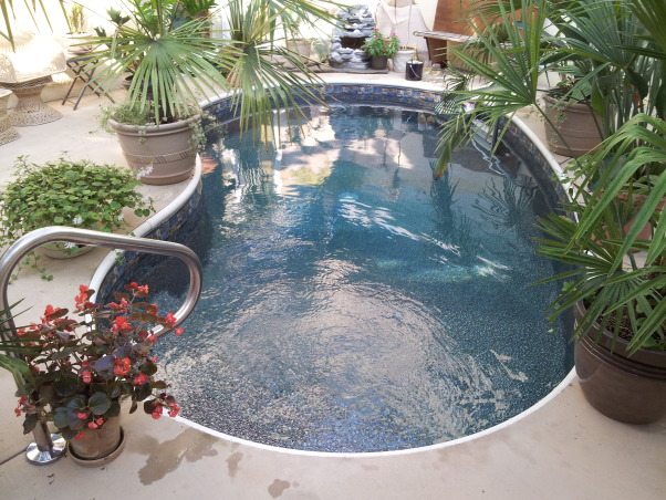 Paradise Awaits You !, A Courtyard home with the backyard outside but within the home., Outdoor Courtyard Pool makes you feel like you're on an Island with the Mural walls.    , Pools Design