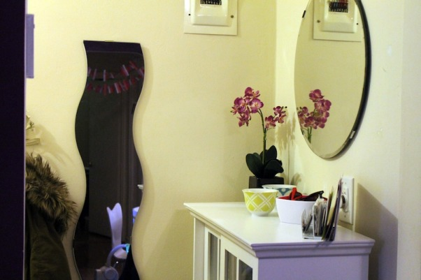Narrow Entryway, This is our front hallway/entryway that is incredibly narrow. Since it's the first thing you see when you walk in, we wanted to make it pretty and obviously, functional. We really started working on it during Apartment Therapy's January Cure, adding hooks, baskets, and decorating the cabinet. It works really well for us and it's nice walking in and seeing something pretty! You can see more details on my blog http://shoes-off-please.com, This is the view from our dining room.    , Other Spaces    Design