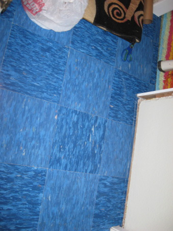 Brown Bag Floor in Hallway, Decided to brown bag over blue vinyl tile in hallway to match dining and living room., Blue vinyl tile in hallway between bedrooms, Other Spaces Design