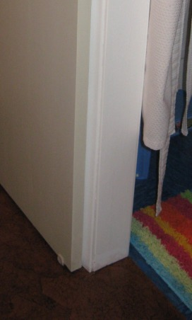 Brown Bag Floor in Hallway, Decided to brown bag over blue vinyl tile in hallway to match dining and living room., decided to extend floor to dorrway opening, Other Spaces Design
