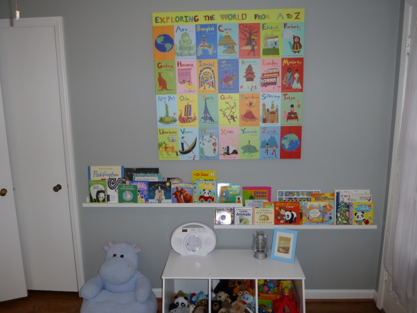 Modern World Travel Nursery, We wanted a space that could easily transition, but still be fun for a baby. Finding the right modern furniture, at a decent price, was quite difficult! The dresser, bookshelves, lamp and rug are ikea, the crib and chair are from Babyletto. The toy chest, curtains and cubes are from Target, as is the small table, which was originally black. The wall decal, framed quote, fabric for the pillow and blanket were all found on etsy with the painting being on oopsydaisy.com. And finally the blinds and shelf above the changing pad are from Lowes. , The books are on photo ledges from Ikea.   , Nurseries Design