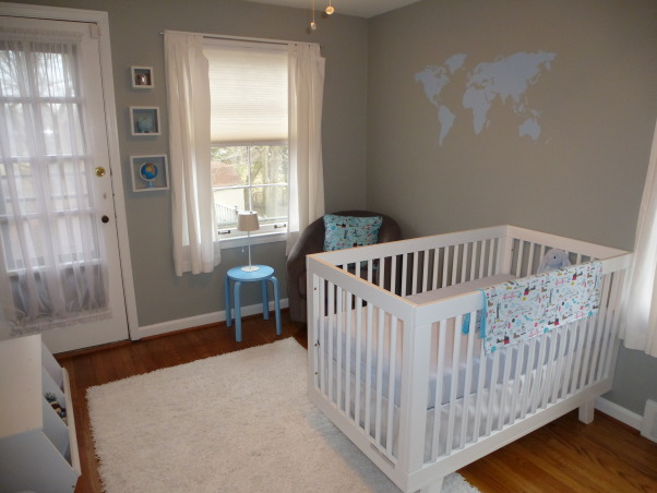 Modern World Travel Nursery, We wanted a space that could easily transition, but still be fun for a baby. Finding the right modern furniture, at a decent price, was quite difficult! The dresser, bookshelves, lamp and rug are ikea, the crib and chair are from Babyletto. The toy chest, curtains and cubes are from Target, as is the small table, which was originally black. The wall decal, framed quote, fabric for the pillow and blanket were all found on etsy with the painting being on oopsydaisy.com. And finally the blinds and shelf above the changing pad are from Lowes. , We wanted to keep it clean and simple.   , Nurseries Design