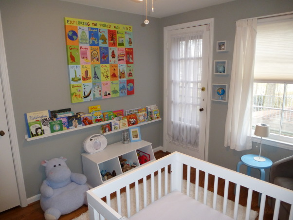 Modern World Travel Nursery, We wanted a space that could easily transition, but still be fun for a baby. Finding the right modern furniture, at a decent price, was quite difficult! The dresser, bookshelves, lamp and rug are ikea, the crib and chair are from Babyletto. The toy chest, curtains and cubes are from Target, as is the small table, which was originally black. The wall decal, framed quote, fabric for the pillow and blanket were all found on etsy with the painting being on oopsydaisy.com. And finally the blinds and shelf above the changing pad are from Lowes. , Nurseries Design