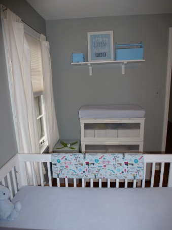Modern World Travel Nursery, We wanted a space that could easily transition, but still be fun for a baby. Finding the right modern furniture, at a decent price, was quite difficult! The dresser, bookshelves, lamp and rug are ikea, the crib and chair are from Babyletto. The toy chest, curtains and cubes are from Target, as is the small table, which was originally black. The wall decal, framed quote, fabric for the pillow and blanket were all found on etsy with the painting being on oopsydaisy.com. And finally the blinds and shelf above the changing pad are from Lowes. , I found a blue spray paint and used it match accent pieces throughout the room.   , Nurseries Design