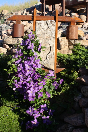 landscape works, photos of projects I have created with rock, metal, wood, and plantings, Stone/Metal Light Fixture with clematis, Gardens Design