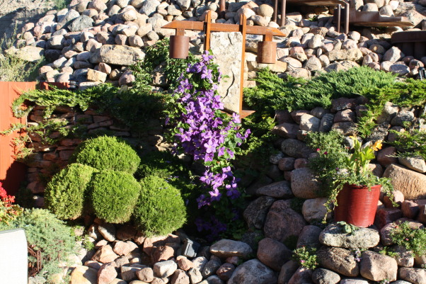 landscape works, photos of projects I have created with rock, metal, wood, and plantings, Stone/Metal Light Fixture, Gardens Design