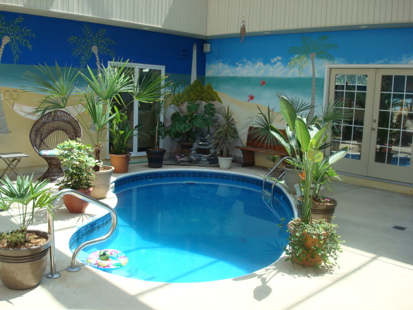 Paradise Awaits You !, A Courtyard home with the backyard outside but within the home., This pic shows more of the Mural walls.  , Pools Design