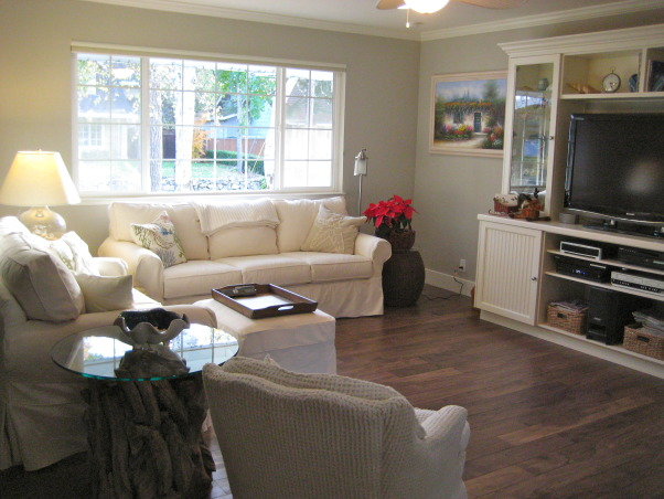"Beach style home's living room., The whole house inside and out has a beach style theme. These floors are aptly named, ""Boardwalk"", the walls are a beach sand color, there are driftwood furniture pieces and accents., Beach style home Living Room   , Living Rooms Design"