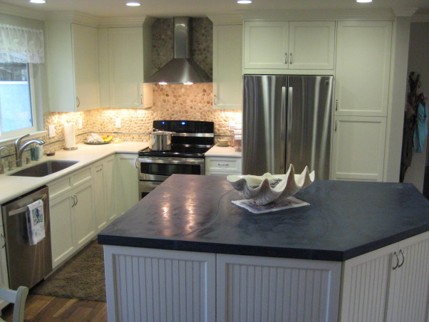 "Beach style house's kitchen..., Beach style house, with wood floors called, ""Boardwalk"", stone back splash, concrete island with 'dremmel' carved shells in corner, and 'beach-glass' looking tiles., Beach style kitchen  , Kitchens Design"