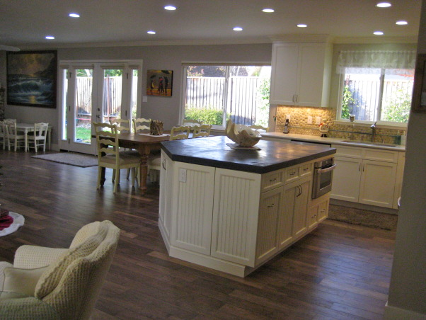 "Beach style house's kitchen..., Beach style house, with wood floors called, ""Boardwalk"", stone back splash, concrete island with 'dremmel' carved shells in corner, and 'beach-glass' looking tiles., Beach Style Home's kitchen....  , Kitchens Design"