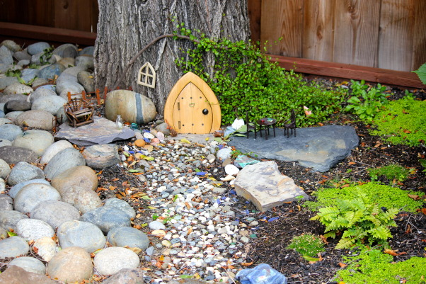 Backyard garden~, Raised beds for vegetables or cutting flowers, a Gnome Tree, flower borders and trees...., Beach Style Home~~  little rock pathway to the Gnomes tree    , Gardens Design