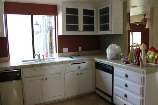 Courtney's Kitchen Reno, We went from drab to fab with this total gut and renovation of our kitchen., Kitchen before with ancient dishwasher and porcelain tile and cabinets mounted too high above the counter.             , Kitchens Design