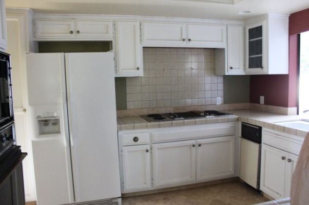 Courtney's Kitchen Reno, We went from drab to fab with this total gut and renovation of our kitchen., Kitchen before with dilapidated electric range and refrigerator beside.             , Kitchens Design