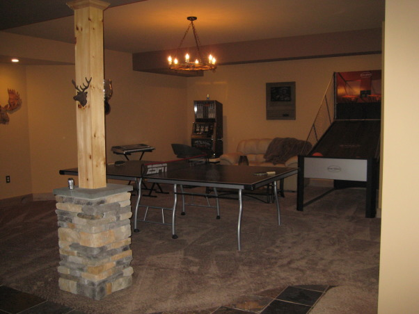 Warm and Cozy in a big space, We just recently finished our basement.  It was a very big and long space.  We wanted to create a warm, cabin like feeling and a space our soon to be teenage daughter could go to hang with friends., Game area., Basements Design