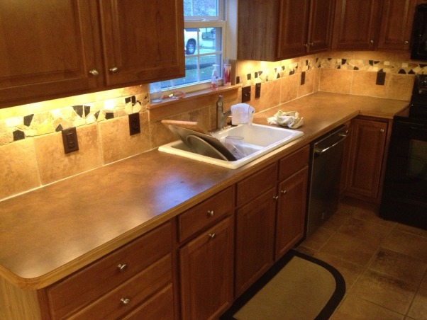 Weekend Reno!, We bought our home a year ago, and the kitchen has been a heel since day one. The countertops were nice, but didn't go with the cherry cabinets. The backsplash matched the floor, and looked dirty always. Now, it's beautiful., Ugly before , Kitchens Design