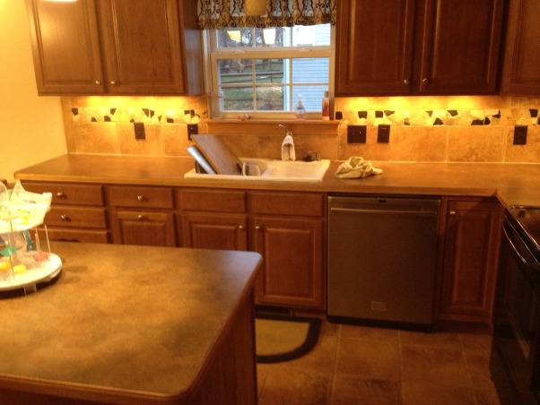 Weekend Reno!, We bought our home a year ago, and the kitchen has been a heel since day one. The countertops were nice, but didn't go with the cherry cabinets. The backsplash matched the floor, and looked dirty always. Now, it's beautiful., More ugly before , Kitchens Design