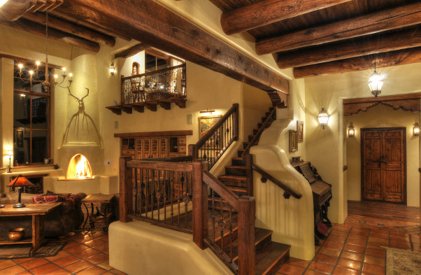 Silverking living room,  We tried to achieve the look of a true pueblo revival that would have been built around 1920 when pueblo revival style first came into being.  There are many reclaimed beams and features in this home., rustic staircase landing , Living Rooms Design