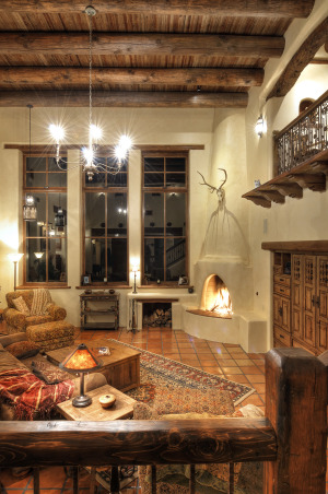 Silverking living room,  We tried to achieve the look of a true pueblo revival that would have been built around 1920 when pueblo revival style first came into being.  There are many reclaimed beams and features in this home., Living Rooms Design