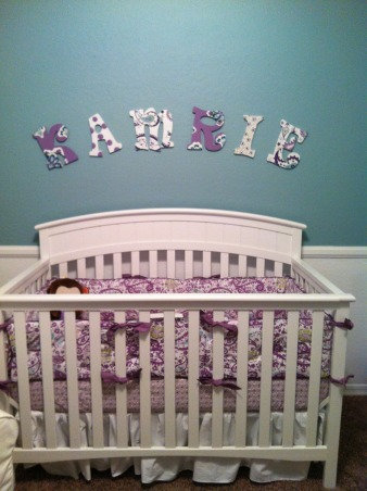 Kamrie's Tranquil Nursery, For our second baby girl's nursery we wanted something different from the usual pink.  I found the bedding at Pottery Barn kids and fell in love with the purple and turquoise color scheme.  We painted the room a relaxing blue/green color and decided to paint below the chair rail white to add definition.  The picture frame wall was an idea from Pinterest.  I made all the quotes on Microsoft Word, and painted and/or Modge Podged all the frames myself.  I love how this room came together.  I'm still always looking for smaller decorations to add to this space.  The colors just make this room feel so comfortable and clean.  I hope little Kamrie enjoys it as much as we do! :), Nurseries Design