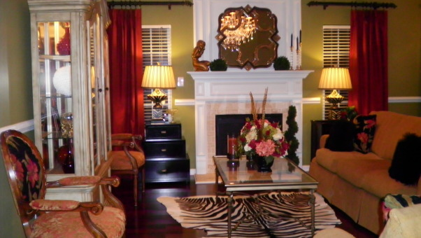 A TWIST ON AFRICAN DESIGN, I wanted to take away peoples idea of african american style and make it more eclectic and traditional along with exotic and bold colors like RED, BLACK, GOLD, ORANGE, and GREEN to give you another way of looking at strong bold and exotic colors and textures in a more sophisticated and elegant way., Living Rooms Design