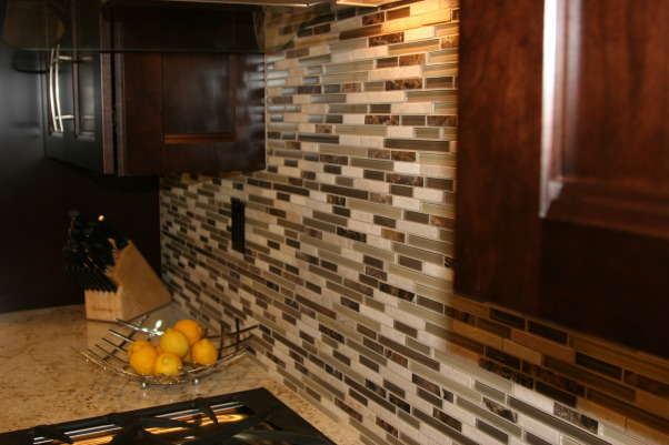transitional/Contemporary/minimalist kitchen makeover(before & after), cookie cutter track  home got a major overhaul from  floor to ceiling. Kitchen is on the small side and the short cabinets made the room feel even smaller. original yellow oak cabinets ,white tile countertops and recessed fluorescent lights from early 2000. Lacked personality and style and very ugly to say the least.  Did my research and laid out a budget before taking the plunge though in the end we nearly doubled the amount spent. project took two months from start(demo) to finish. , Here's a real close look at the backsplash.    , Kitchens Design