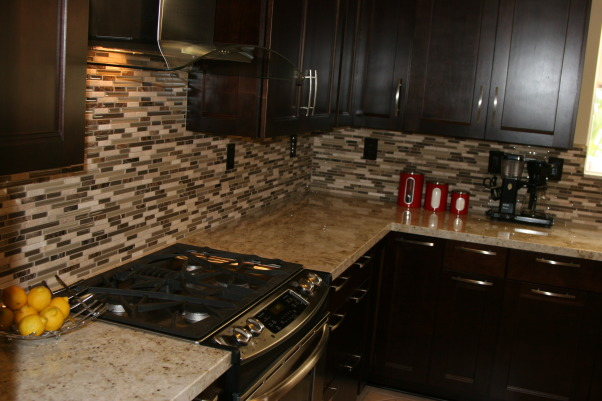 transitional/Contemporary/minimalist kitchen makeover(before & after), cookie cutter track  home got a major overhaul from  floor to ceiling. Kitchen is on the small side and the short cabinets made the room feel even smaller. original yellow oak cabinets ,white tile countertops and recessed fluorescent lights from early 2000. Lacked personality and style and very ugly to say the least.  Did my research and laid out a budget before taking the plunge though in the end we nearly doubled the amount spent. project took two months from start(demo) to finish. , Stainless and glass range hood.    , Kitchens Design