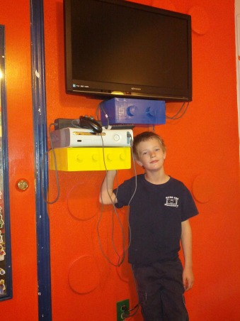 LEGO, My Grandssons B-Gift was a new bedroom, On the orange Lego wall, grandpa made shelves for the flat screen and the Xbox! There's the grandson. , Boys' Rooms Design