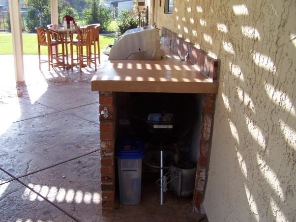 Patio makeover and out door kitchen, updated and enlarged patio with an added outdoor kitchen, We can keep the Weber tucked neatly away on one end. , Patios & Decks Design