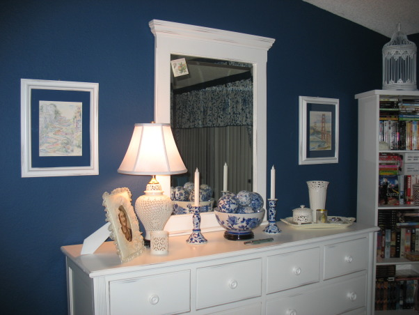 Blue Bedroom, My redecorated blue bedroom.  Calm, peaceful, serene blue color.  Filled with country, asian inspired antique pieces. , Locally purchased watercolors from San Francisco's Fisherman's Wharf area surround the Country dresser with vivid blue walls.    , Bedrooms Design
