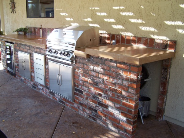 "Patio makeover and out door kitchen, updated and enlarged patio with an added outdoor kitchen, The raised counter at one end allowed room for our ""Weber Garage"" to park the charcoal grill.  It also broke up the 15' long counter top. , Patios & Decks Design"