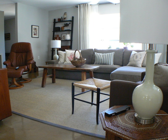 Change for the seasons, 15 x 19 Living/Family room area painted in Dove grey. Ikea sofa/sectional in grey-brown cordoroy covers, Classic slope arm chair, old wood bench/coffee table, teak end tables in separate styles, Stressless recliner. Blend of old and new . Refinished concrete floors with sisal area rug. Kids and cat friendly!, New cased glass lamps...they sometimes look grey, sometimes off white, and sometimes aqua depending on the light.   , Living Rooms    Design
