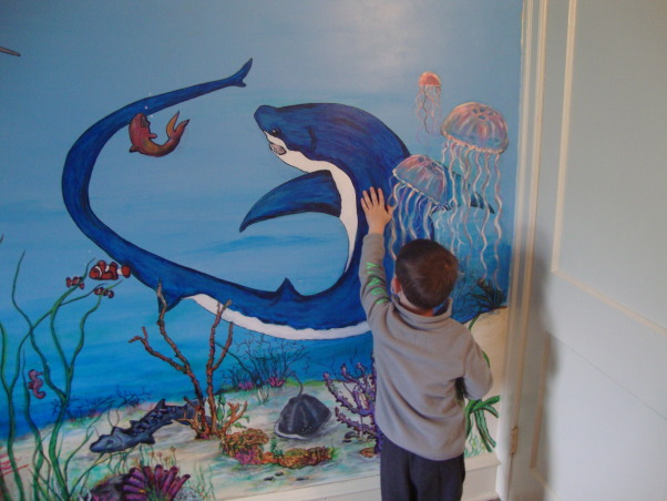 Under the sea, This is my grandson Gavin's new under the sea bedroom. He loves sharks so you can see there are a lot of different kinds of sharks. He kept asking me to add more and more fish till I finally had to tell him that he needed a bigger room. LOL, Gavin pointing at the Thrasher shark, Boys' Rooms Design