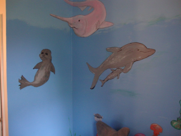Under the sea, This is my grandson Gavin's new under the sea bedroom. He loves sharks so you can see there are a lot of different kinds of sharks. He kept asking me to add more and more fish till I finally had to tell him that he needed a bigger room. LOL, His daddy painted the baby seal....:), Boys' Rooms Design