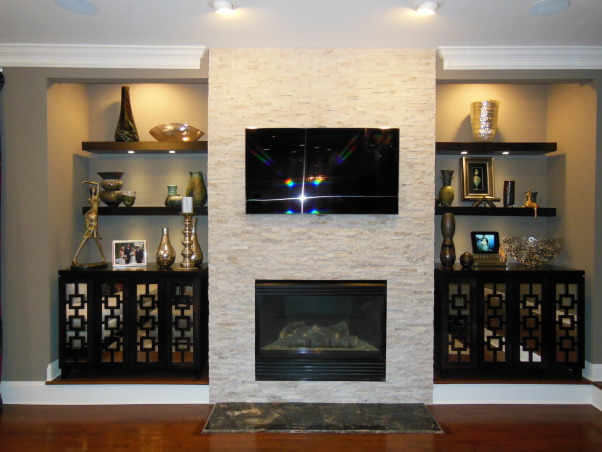 Remodeled Living Room/fireplace, We removed  our old fireplace and cabinets and updated with a stone fireplace and custom consoles and floating shelves. , Stone fireplace that wraps around the wall.    , Living Rooms    Design