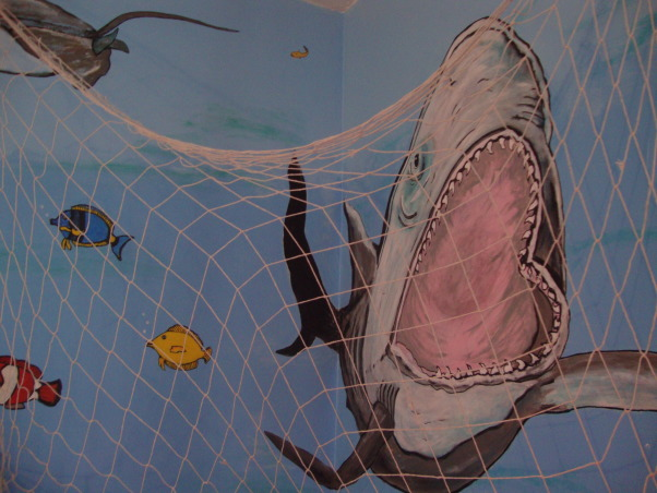 Under the sea, This is my grandson Gavin's new under the sea bedroom. He loves sharks so you can see there are a lot of different kinds of sharks. He kept asking me to add more and more fish till I finally had to tell him that he needed a bigger room. LOL, We caught him!!!! :), Boys' Rooms Design