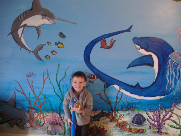 Under the sea, This is my grandson Gavin's new under the sea bedroom. He loves sharks so you can see there are a lot of different kinds of sharks. He kept asking me to add more and more fish till I finally had to tell him that he needed a bigger room. LOL, This is happy Gavin and his new room...:), Boys' Rooms Design