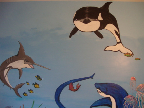 Under the sea, This is my grandson Gavin's new under the sea bedroom. He loves sharks so you can see there are a lot of different kinds of sharks. He kept asking me to add more and more fish till I finally had to tell him that he needed a bigger room. LOL, Mr. Whale has google eyes lol, Boys' Rooms Design