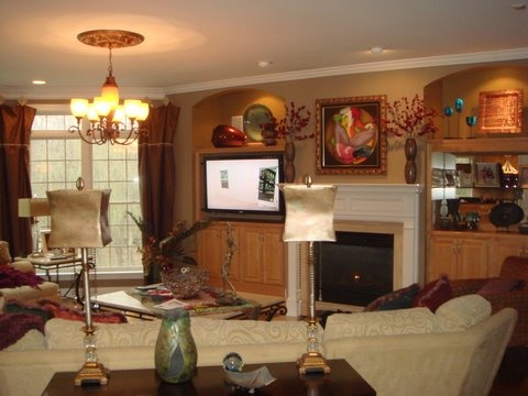 Remodeled Living Room/fireplace, We removed  our old fireplace and cabinets and updated with a stone fireplace and custom consoles and floating shelves. , before photo, Living Rooms    Design