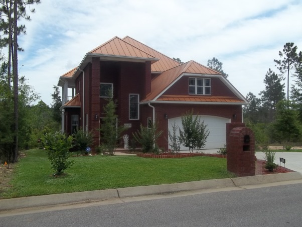 Copper Roof, Brand new All brick exterior with standing seam copper roof.  This European custom home is Functional, energy efficient  and Beautiful. The wrap around decks allow peaceful views of the nature preserve.  Inside you will find gorgeous 10 foot ceilings, handscraped hardwood on both floors(no carpet) 4 bedrooms, 4 baths, 2 masters, one each level with Spa bathrooms, large soaking tubs, tile walk in showers.  Upstairs a large  Loft area and bonus room. A second master suite with Spa bath guest suite with ensuite bath and lovely views from every window. Water closets located in each bathroom with esquisite chandeliers  The patio size lot keeps upkeep easy, Home Exterior Design